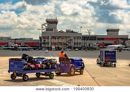 Atlanta Georgia USA - July 12 2017: TSA workers transport baggage from a recently landed flight at Hartsfield-Jackson International Airport.