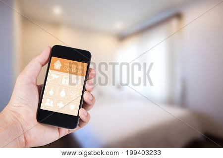 Hand using smartphone to smart home app on mobile for remote control everything in home by wifi network.