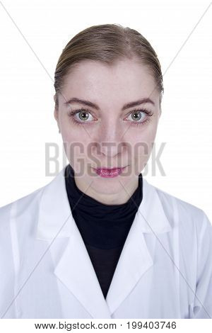 Young blonde woman in white lab coat on white background