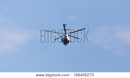helicopter on a blue sky . A photo