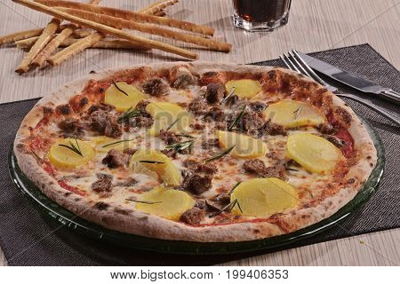 Pizza with potatoes and olives.