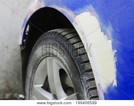 Car under repair in a car body shop