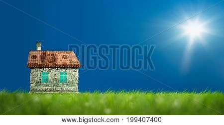 Conceptual image of money house on green landscape