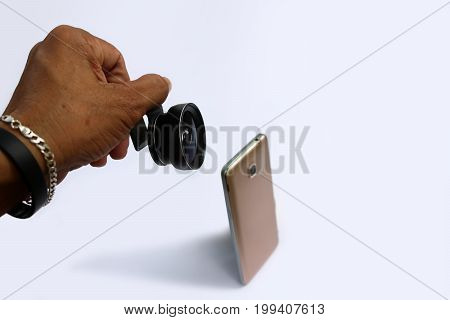 Clip lens for connect with mobile phones in white background.