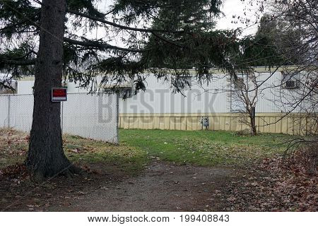 SHOREWOOD, ILLINOIS / UNITED STATES - DECEMBER 6, 2015: Trailers in the Imperial Mobile Home Community abut the Hammel Woods Forest Preserve.