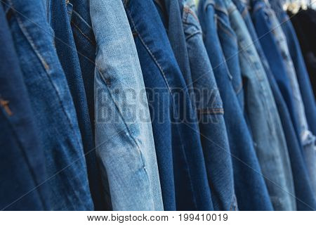 Blue denim jeans background. Blue jeans lined in market.