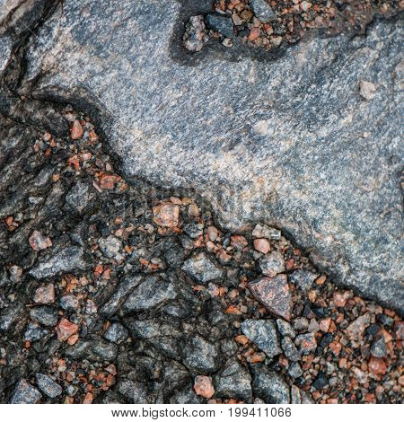 surface of old granite stones. gray pink brown