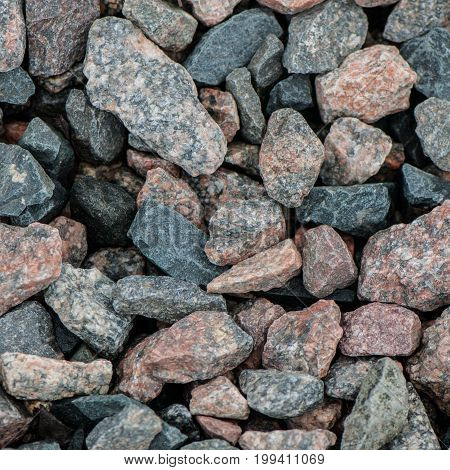 surface of granite stones. gray pink blue