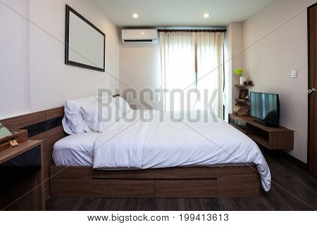 Bedroom With Furniture And Facility Inside Room In Condominium.