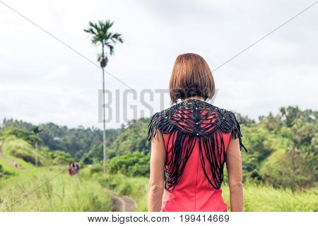 Young Sexy Woman In Red Dress In The Tropical Landscape Of Bali Island, Indonesia. Woman Having Summ
