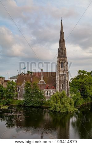 Sunset view on the St. Alban's Church and the pond in Copenhagen, Denmark