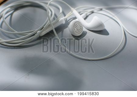 White earphone on table, earphone, phone , background