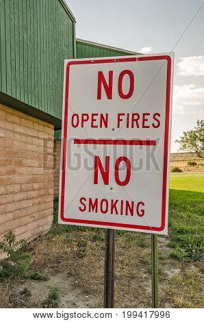 Sign to remind travelers at a rest stop in Wyoming that there is a serious drought and no one can have open fires or smoke in the rest area