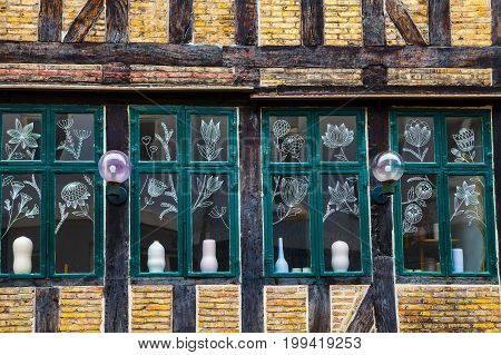 Vintage windows decorated with painting of flowers. Copenhagen, Denmark.