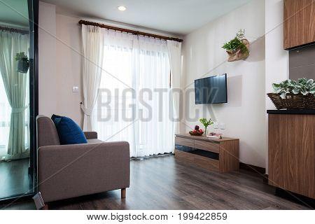Corner Living Room In Condominium On High Floor.