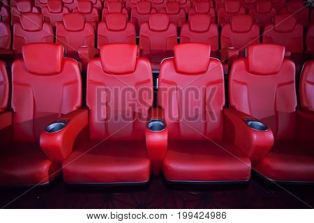 Red Seat In The Movie Theater. Blurry Background.