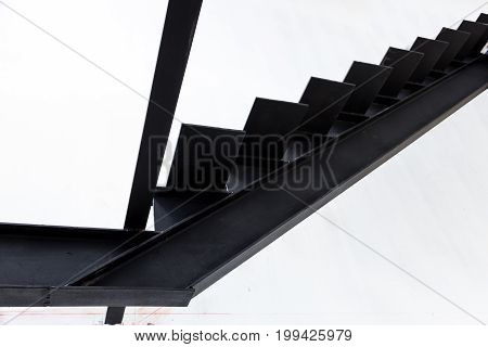 Installation of steel stairs using steel i-beams.