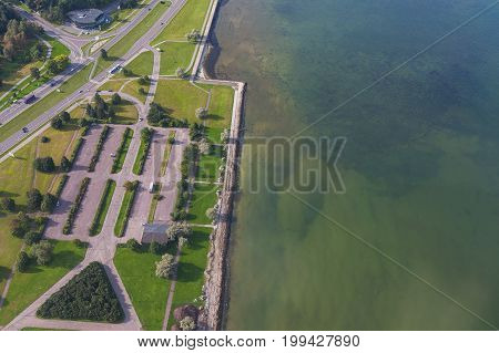 Aerial view on a road and city park along sea shore. Tallinn, Estonia