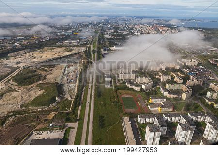 Aerial view of an European suburb. Old ore mine and living blocks.