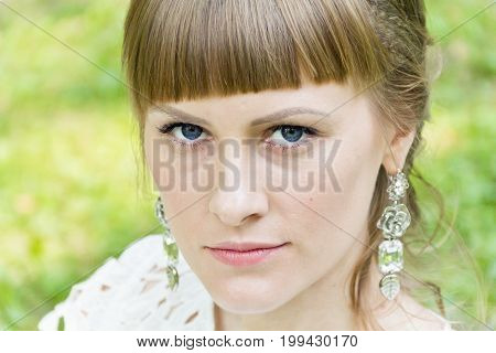 Beautiful bride with diadem on green background