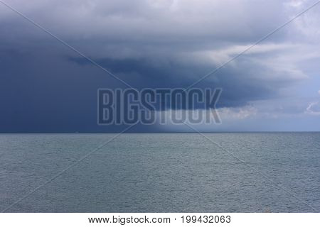 rain clouds and storm front over the sea