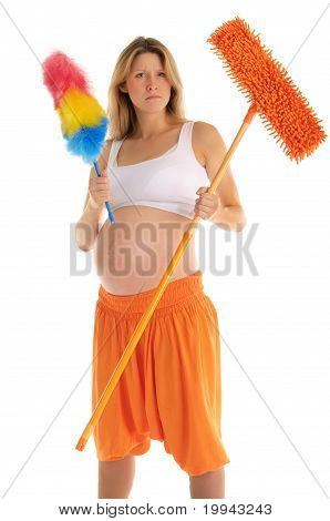 angry pregnant woman with a mop