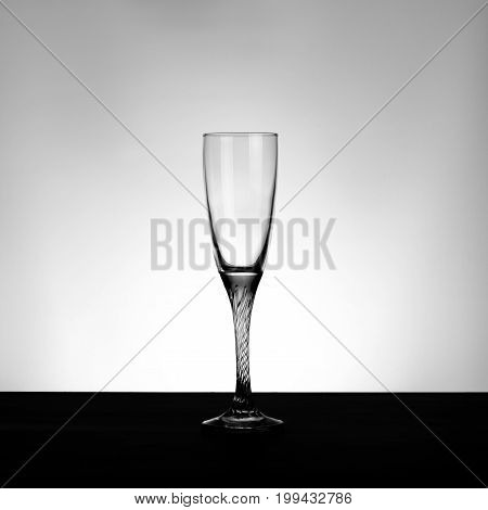 Glass of champagne standing on a black table