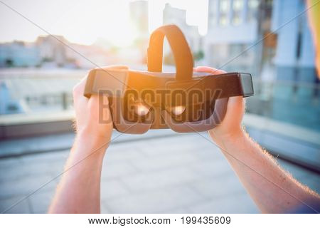 Vr Goggles In Male Hands. Man Ready To Wear Virtual Reality Goggles. The Vr Headset Design Is Generi