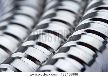 macro closeup of metallic corrugated tube texture