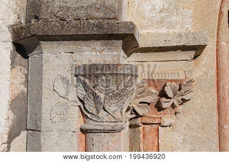 Stone carvings around the entrance portal. Wall of old Lutheran church, Saaremaa island, Estonia.