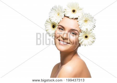beautiful young woman with natural makeup and white Herberas flowers on head. beauty shot isolated on white background. copy space.