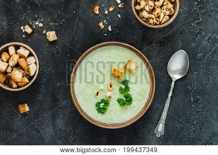 Green Healthy Cream Soup With  Broccoli, Crackers, Cashew, Parsley. Top View