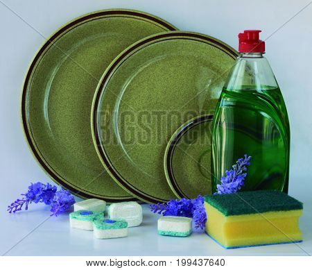 Liquid soap and tablets for cleaning dishes.