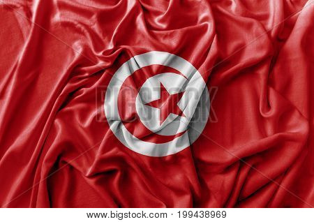 Ruffled waving Tunisia flag national flag close