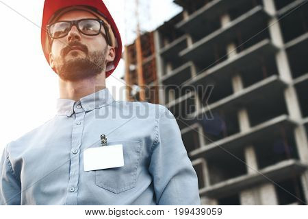 Young Modern Engineer Builder With Empty Blank Badge On His Chest