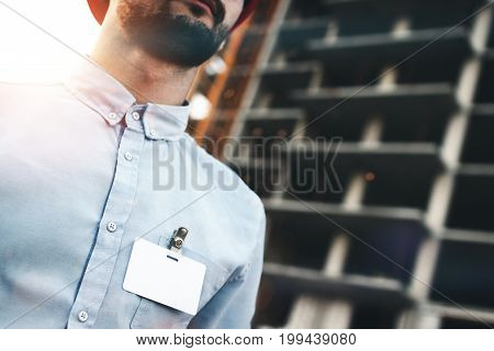 Blank Empty Badge Or Business Card On Chest Of Engineer's Builder's Shirt On The Background Of Const