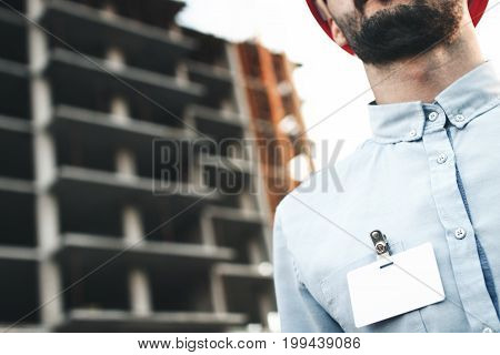 Blank White Blank Card Or Business Card Badge On Chest Of Young Architect Or Engineer On Background