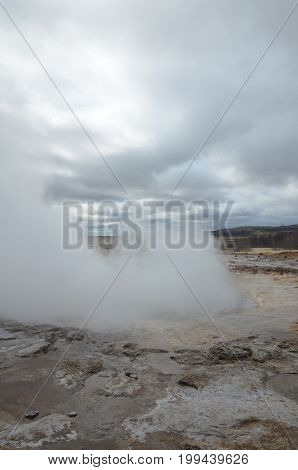 Blow hole of Strokkur geyser steaming after it blows.