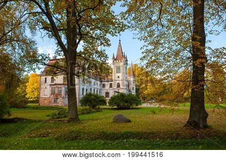 Old fairy-tale palace in Stameriena, Latvia. Fall time, bright colors.