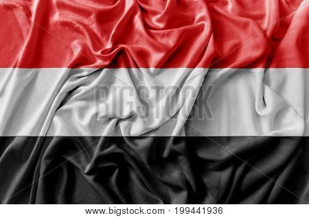 Ruffled waving Yemen flag national flag close