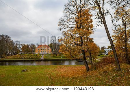 Fall time in the richest manor in Estonia - Palmse. Pond and park view.