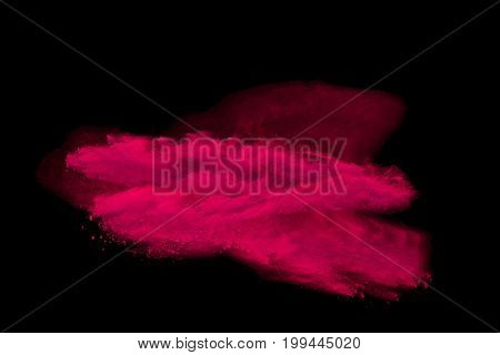 Explosion of colored powder explosion on black background.