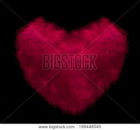 Red heart made of powder explosion isolated on black background.