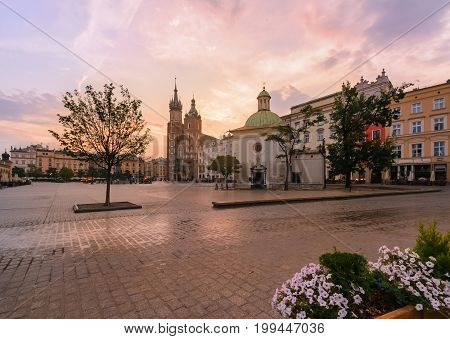 Krakow Market Square in pink sunrise. Poland Europe.