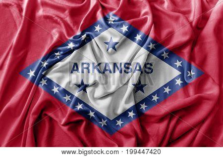 Ruffled waving United States Arkansas flag close