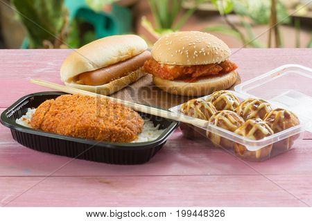 Fast food set / Fried pork topped on rice (tonkatsu) Tako Yaki Chicken burger and Hotdog