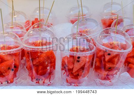 Pieces Of Cut Up Watermelon In A Clear Plastic Cup On A Hot Day