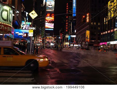 12th Dec 2016. New York Taxi approaching Times Square. Nov 12th 2016. New York's cabs face uncertain future in wake of Uber and Lyft.