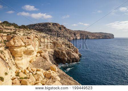 Blue Grotto limestone cliff, majestic nature landmark of Malta island