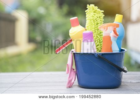 House cleaning product on wood table, close up
